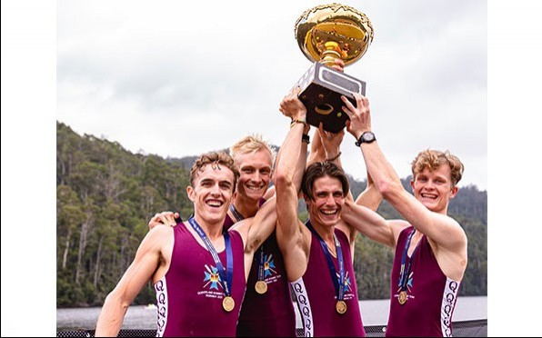 Christian Place (second from right) winning the Interstate Men's lightweight coxless four title.